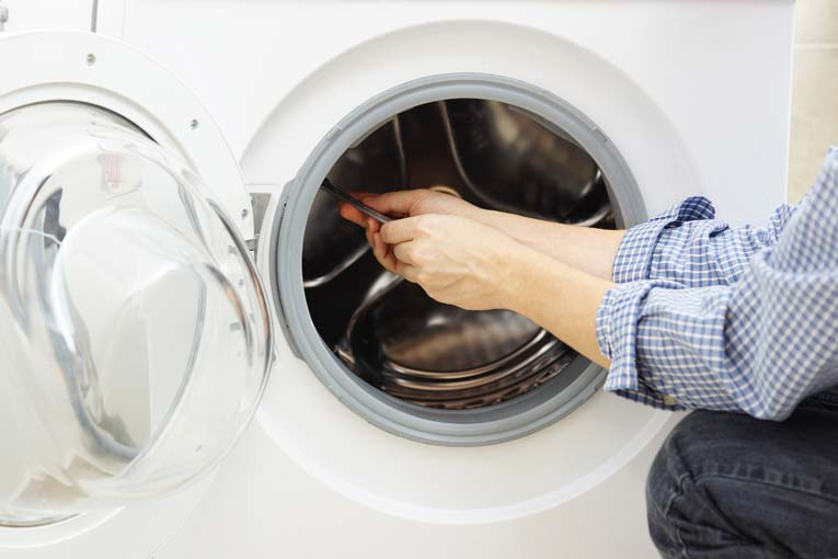 washing machine repair in sharjah picture